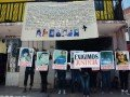 families and friends protest disappearance of seven young people