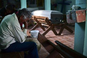 A man mourns the loss of a loved one in the Zacatecas accident