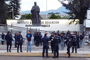 Police stand guard outside IEPPO offices in Oaxaca