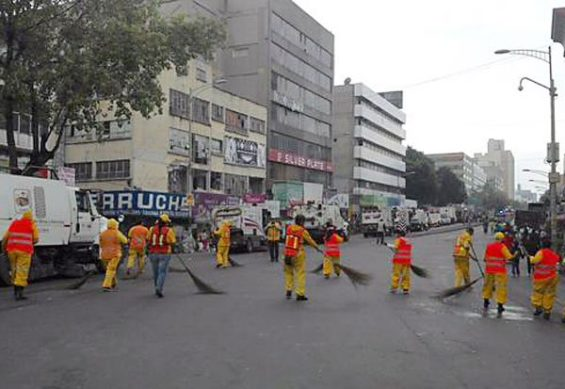 Cleaners at work after independence celebrations in the capital.