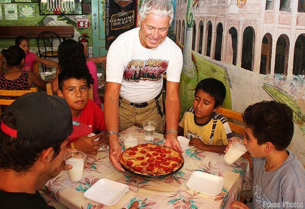 Arsenault serves pizza to youths from Colonia Volcanes