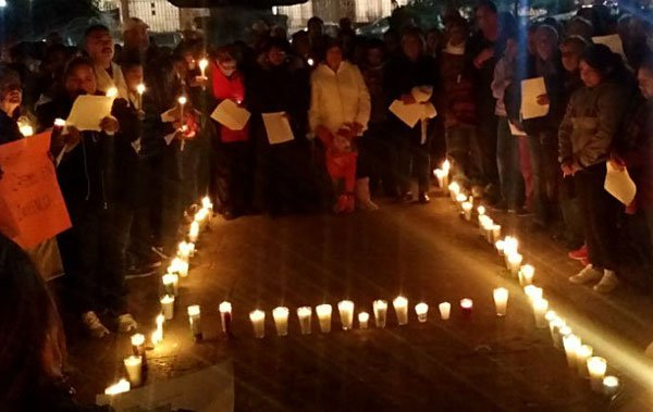 Supporters of Moreira hold a candlelight vigil following his arrest last month in Spain