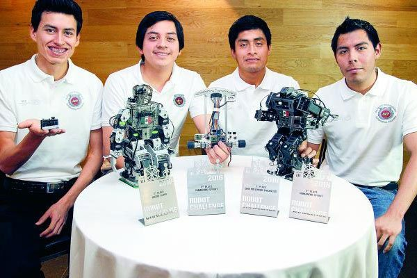 Some of the winning students and their robotics in Vienna.