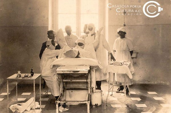 Childbirth in a turn-of-the-century maternity ward.