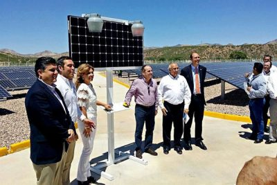 Officials at yesterday's ceremony with solar panels in the background.