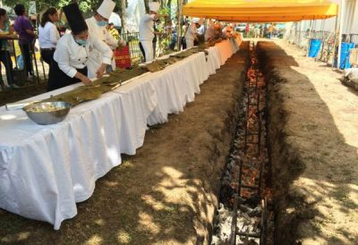Chefs prepare longest tamal before cooking it over hot coals.