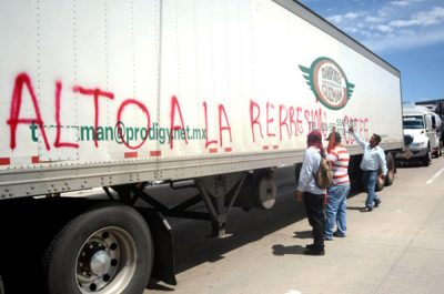Union members paint a hijacked truck in Guerrero.