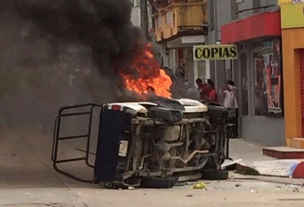 A police vehicle burns in Palenque.