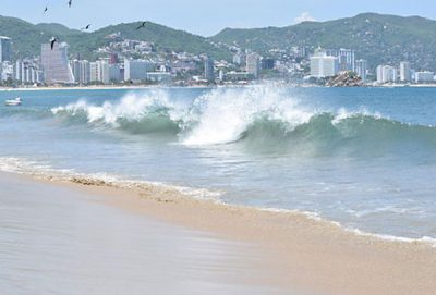 A tropical storm is causing big waves in Acapulco.