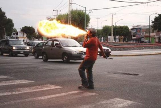 A fire eater at work.