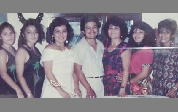 Freddy Medina, his mother and sisters in the 1980s.