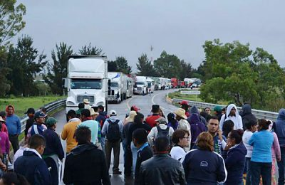 Trucks lined up at a Oaxaca blockade.