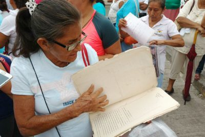 One of the affected residents with her land title documents.