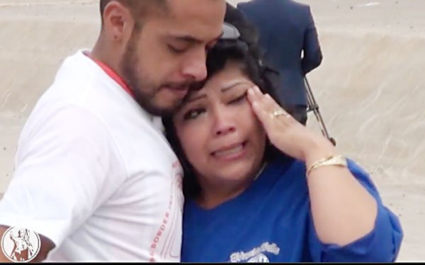 Mother and son hug on the border yesterday.
