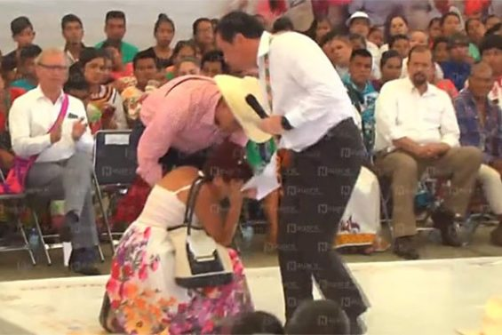 A woman falls to her knees during a plea for help in Tepic yesterday.