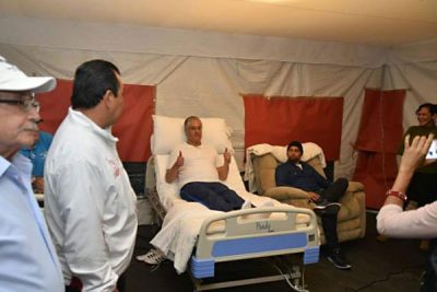 Rector Vera Jiménez in his hospital bed