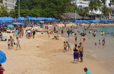 Tourists enjoy the beach in Acapulco.