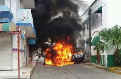 A police vehicle burns in Catemaco.