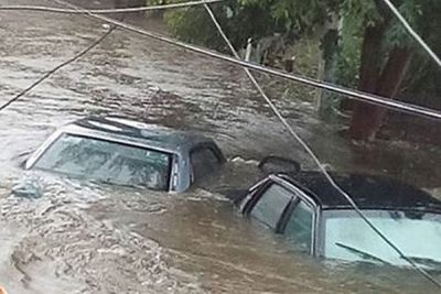 Vehicles trapped in flood waters in Madero.