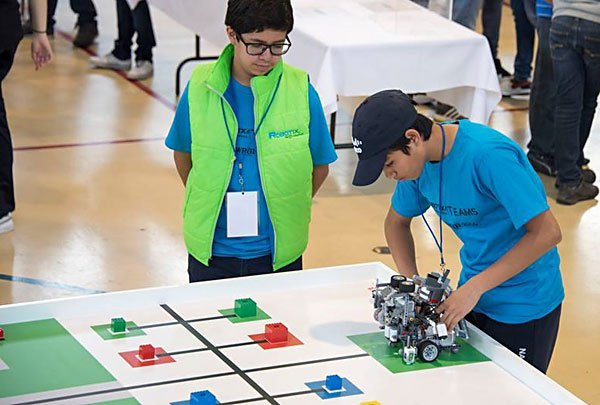 Zárate and Salazar with their robot.