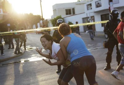 A woman reacts to a massacre perpetrated by the Gulf Cartel.