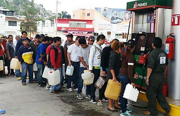 Consumers line up with their gas containers as shortages continue.