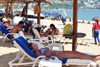 Tourists enjoy a beach in Acapulco.