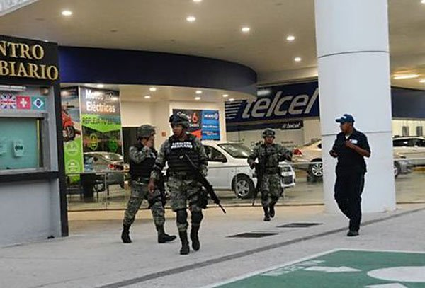 Soldiers patrol in Cancún after the shootings.