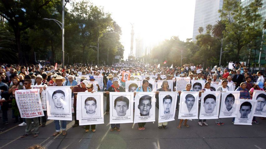 Demonstrators march for the missing Ayotzinapa students.