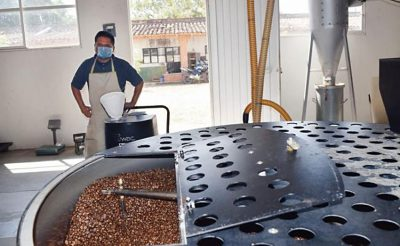 Processing coffee for export in Oaxaca.
