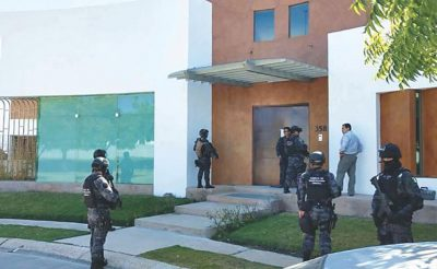 Police outside the home of Duarte's in-laws on Saturday.