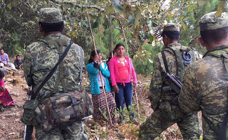 Women and children confront soldiers in Oaxaca this week