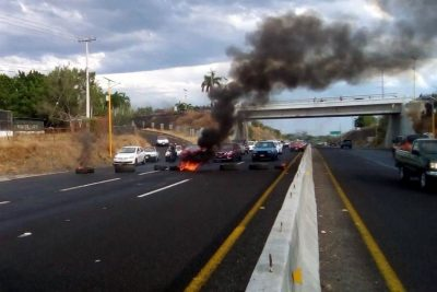 Followers of 'El Chanda' burn tires on a highway after his arrest on Sunday.