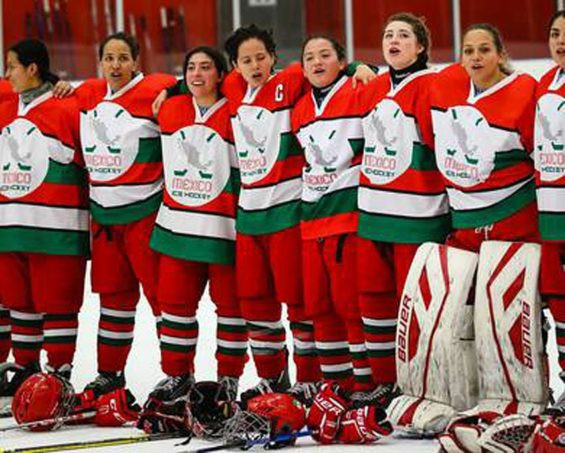 Mexico's women's ice hockey team sings the anthem after their win in Iceland.