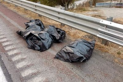 Bodies at the side of a Guerrero highway yesterday.