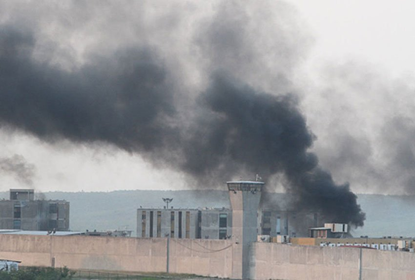 Smoke billows from the Cadereyta prison