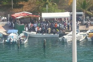 Friends and family greet the rescued fishermen yesterday