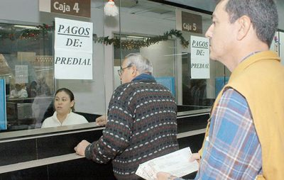 Property owners line up to pay taxes at a government office.