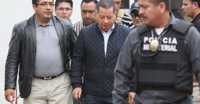 Ríos, center, during his arrest on Sunday.