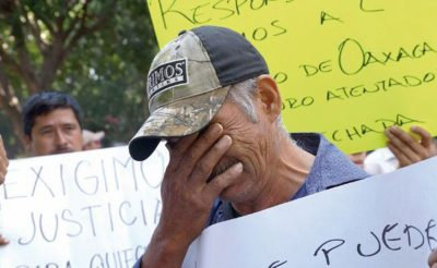 Father of one of the ambush victims at a demonstration in Oaxaca.