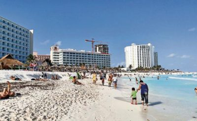 Beach-goers in Cancún: not many are residents.