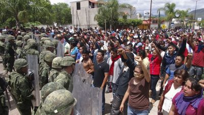 Mexican protesters confront the marines sent in to disband them