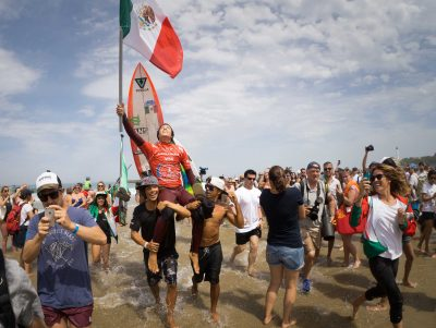 Gold medal winner Corzo waves the Mexican flag yesterday in Biarritz, France.