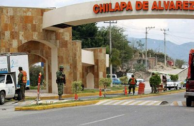 Drivers are checked by security forces in Chilapa.