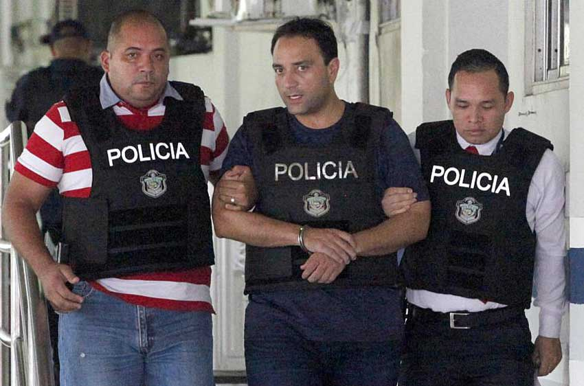 Borge, in handcuffs, is escorted by police in Panama.