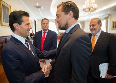Peña Nieto shakes hands with DiCaprio yesterday as a smiling Slim looks on.