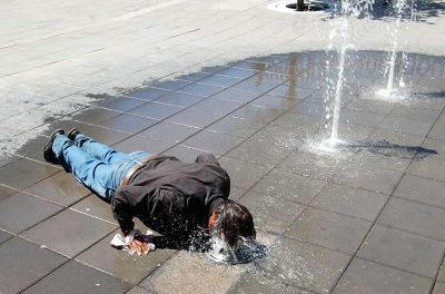 Fountain provides relief to a Chihuahua man during a previous heat wave