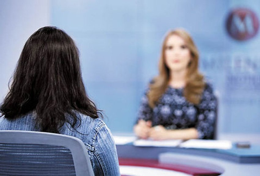 The victim, left, during a TV interview.