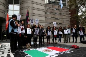 Protesters hold images of murdered journalists.