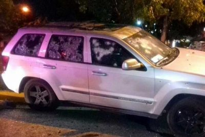 A car that was shot up last night in Cancún.